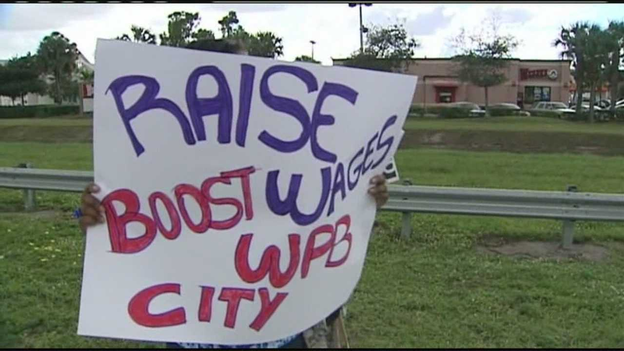 A group of fast-food restaurant workers gather in West Palm Beach to protest poor wages and demand that they be paid $15 an hour.