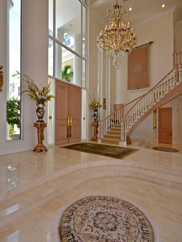 A dramatic foyer sets the tone for the expensive home.