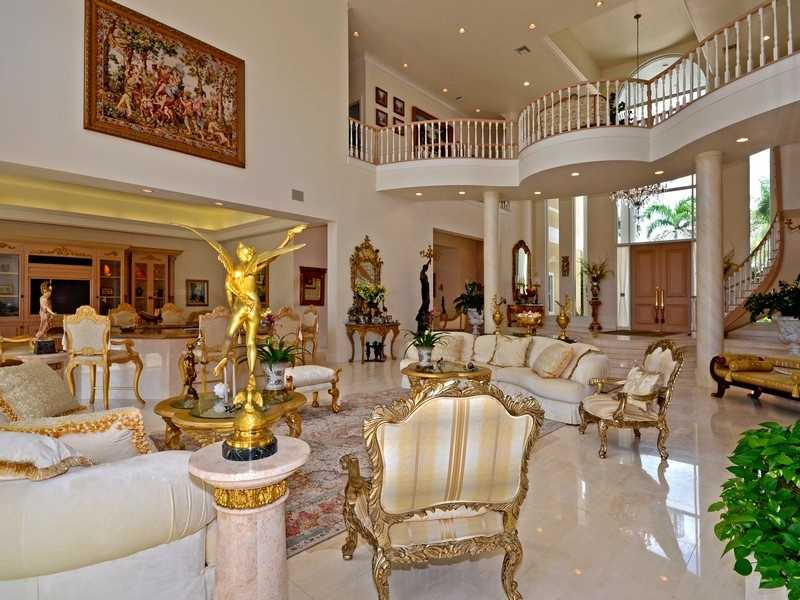 The home's balcony sprawls across the length of the foyer.