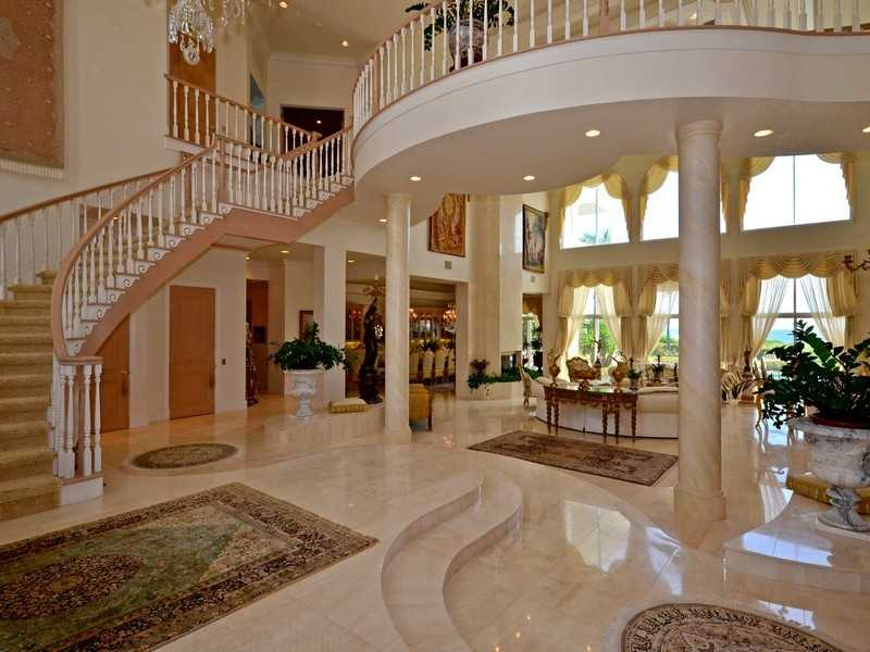 Marble floors lead up to a winding staircase.