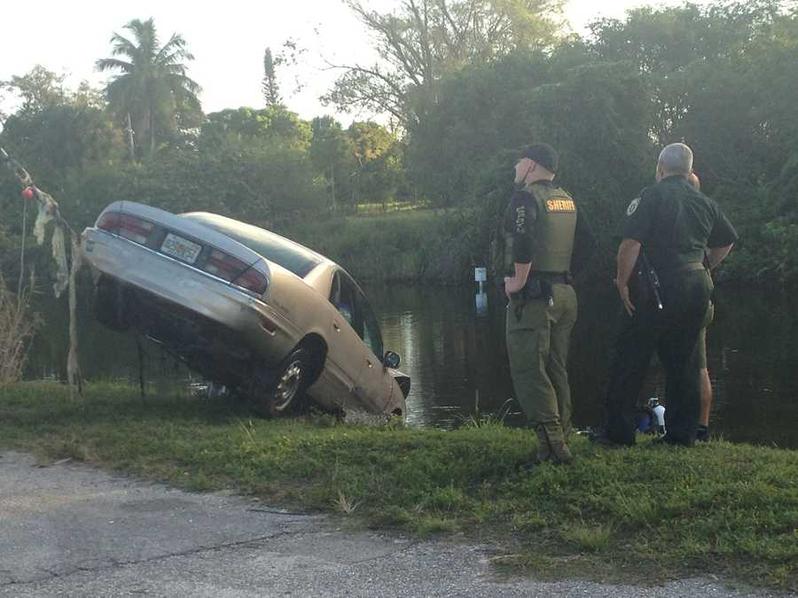 Here are a few photos WPBF 25 News reporter Chris McGrath took of a car being pulled from a canal after a traffic stop led to a chase with police.