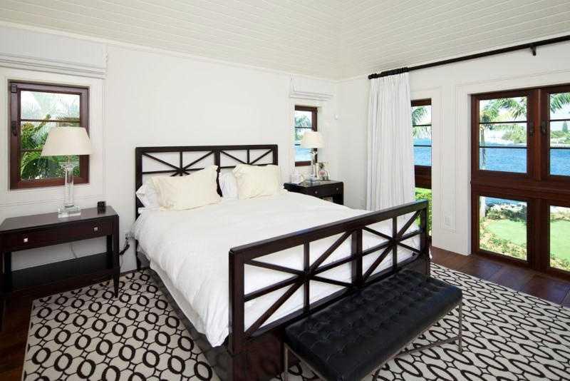 Master bedroom features long, unique tier, windows.