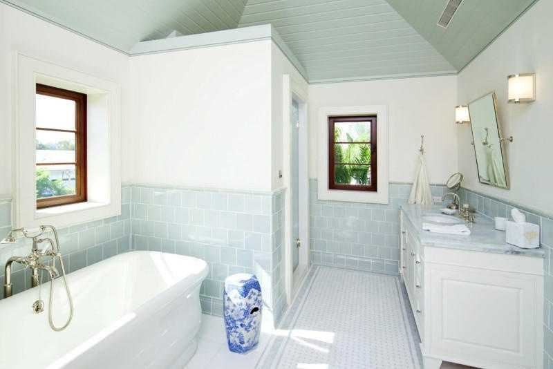 Light blue and mint accents give a fresh look to the master bathroom.