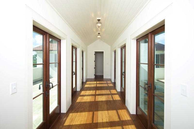 This hallway features french doors on both sides providing the perfect dose of natural light.