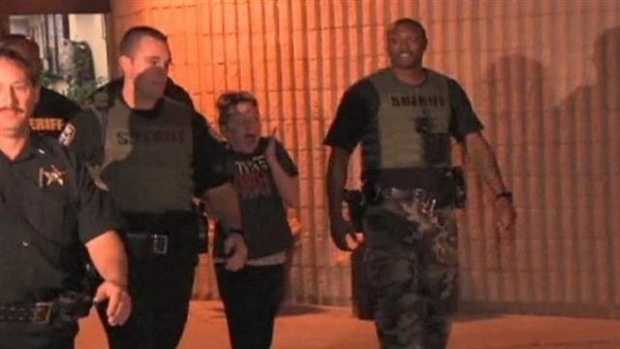Kaitlyn Hunt leaves the Indian River County Jail surrounded by deputies early Friday morning.