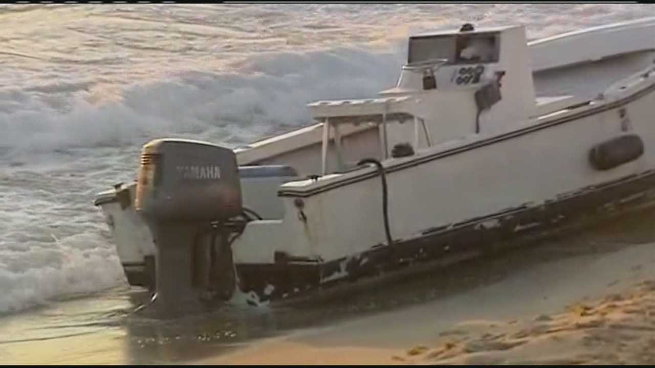 Six migrants were taken into custody after they came ashore in this boat on Palm Beach.