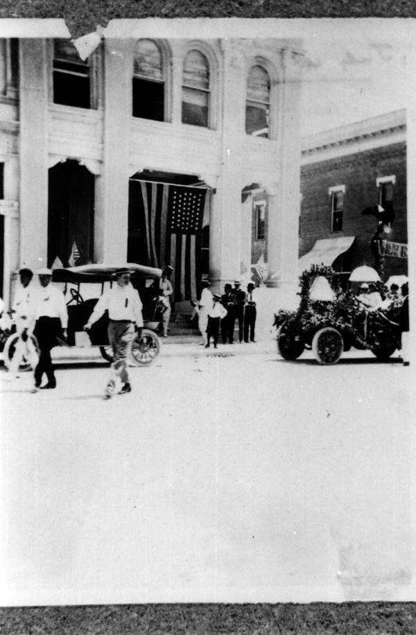Parade on Clematis Street, pre-1920.