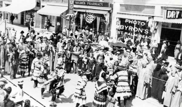 """Seminole Indians dancing during the """"Seminole Sun Dance"""" festival on Clematis Street, pre-1924."""
