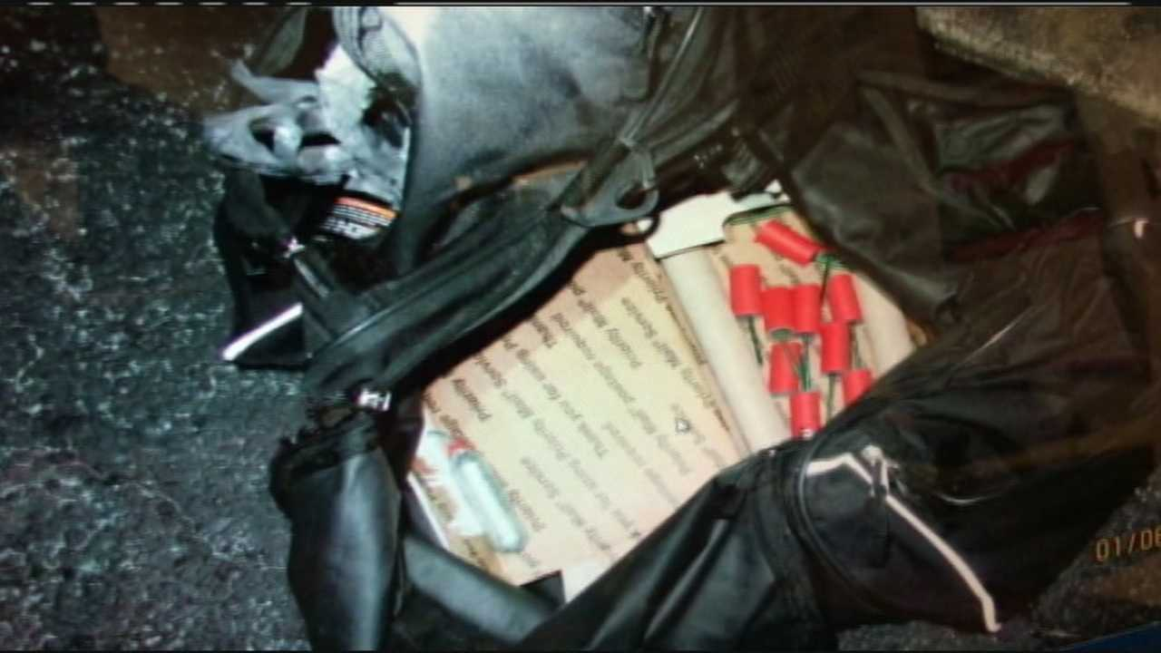 An Okeechobee police officer found explosives, guns and masks inside a car during a traffic stop on Monday.