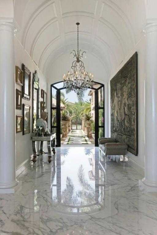 Grand foyer entrance with Large slab marble floors.