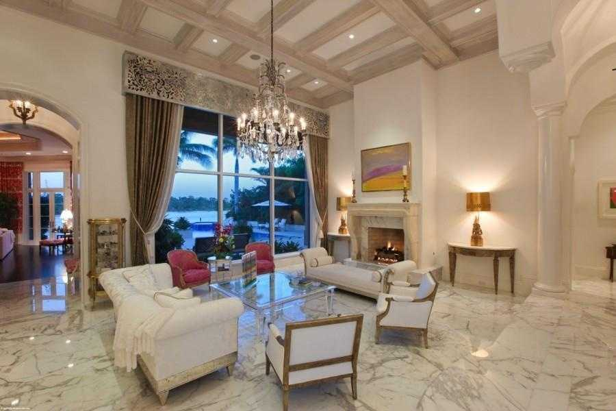 The marble floors continue into the formal living room.