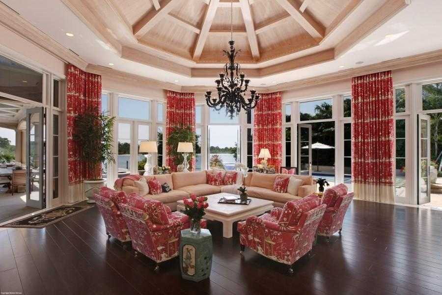 Custom wood ceiling covers this gorgeous family room, which offers panoramic views of the ocean and wildlife.