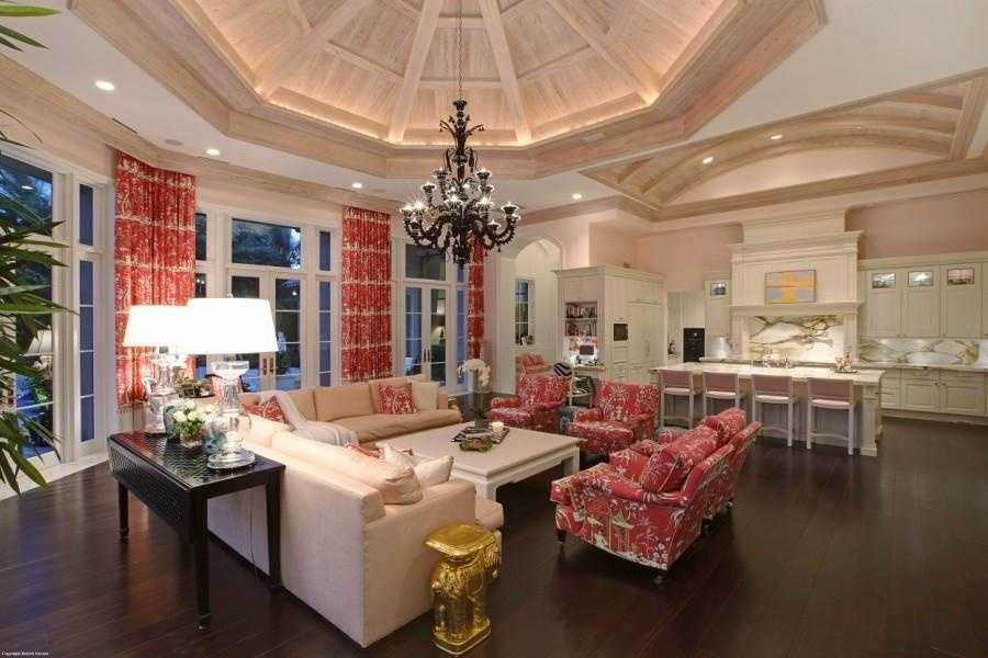 The home has an open layout between the family room and kitchen.