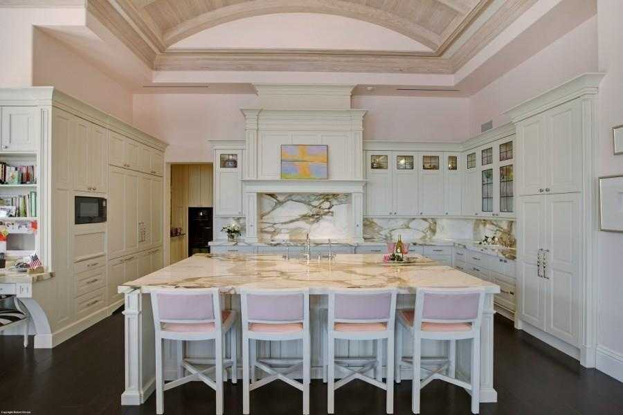 The incredible kitchen features a massive marble island.