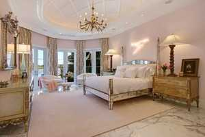 "The master bedroom feels like a ""powder pink palace""."