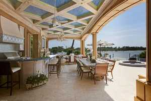 Extravagant outdoor dining overlooks the Intracoastal.