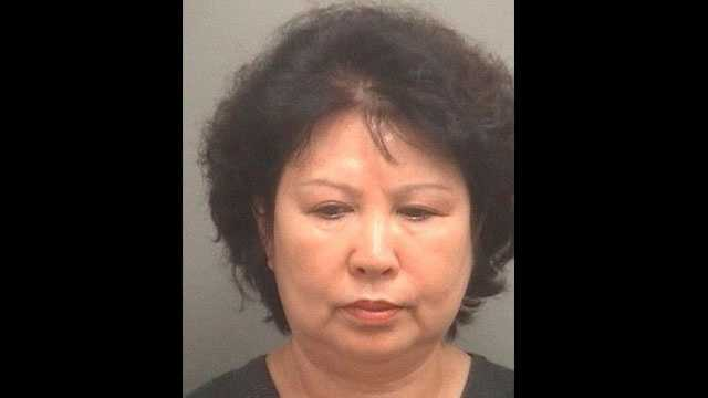 Hyun Suk Moon is accused of selling counterfeit purses from her booth at the 45th Street Flea Market.
