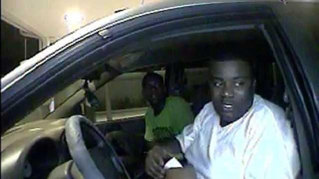 Police are trying to identify these two men who used a robbery victim's stolen credit cards at a PNC Bank drive-through in Boynton Beach.