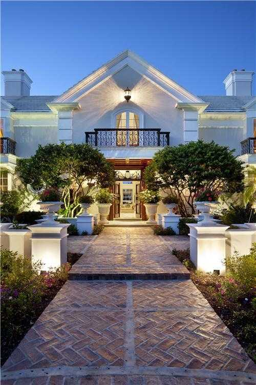 Calculated spot-lighting creates a romantic ambiance at the home's entrance.
