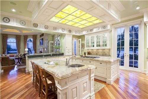 The gourmet kitchen is as beautiful as it is practical for an entertaining atmosphere.