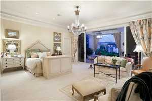 The master bedroom features elegant and understated antique touches.