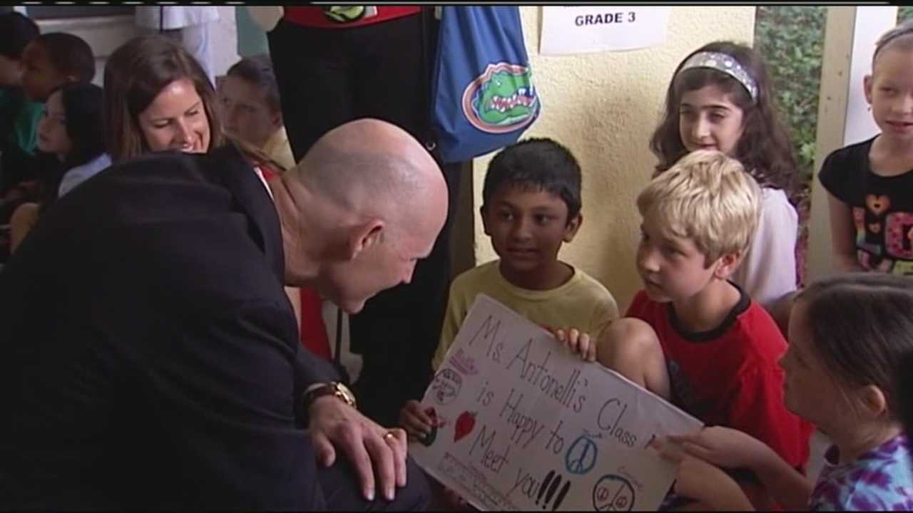 Gov. Rick Scott visits with students at S.D. Spady Elementary School in Delray Beach.