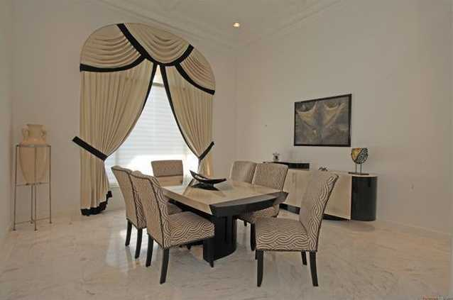 Formal dining room features a modern edge.