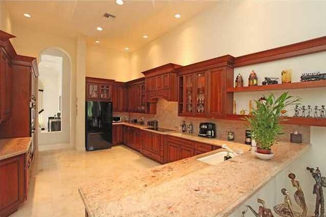 Granite gourmet kitchen with custom cabinets, over-sized pantry, and pull out shelves.