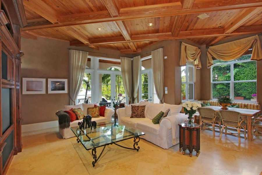 Impressive Pecky cypress ceilings & Jerusalem flooring in the family room.