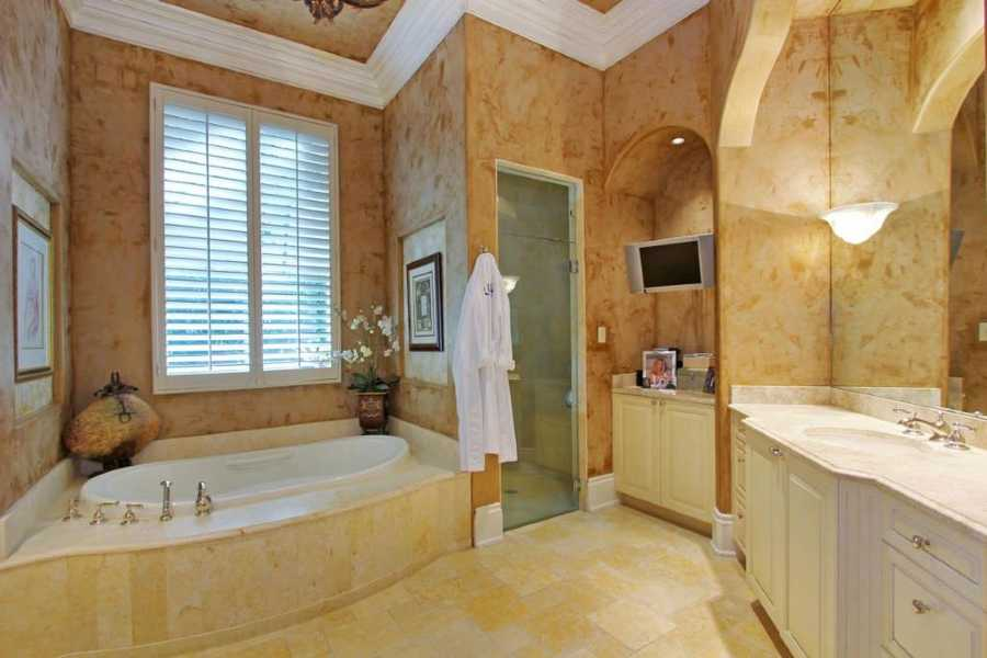 Master bathroom features a gracious spa tub.