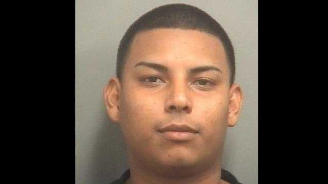 Edward Ulloa is accused of passing counterfeit $100 bills at the Mall at Wellington Green.