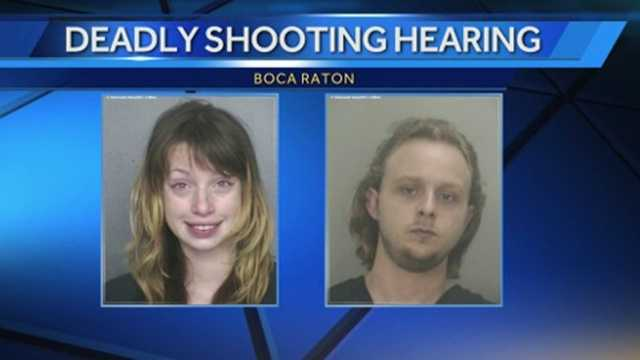 The man and woman accused in the shooting death of the woman's boyfriend made their first court appearance on Wednesday.
