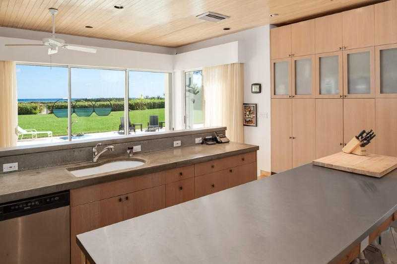 The kitchen overlooks the ocean as well and features a large cooking island and custom cabinets.