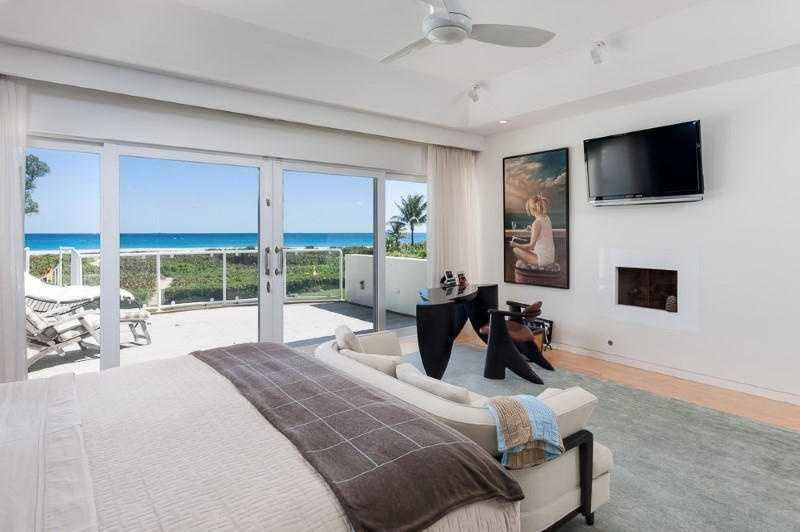 Second-floor master suite includes a gracious balcony/sun deck for private relaxation.