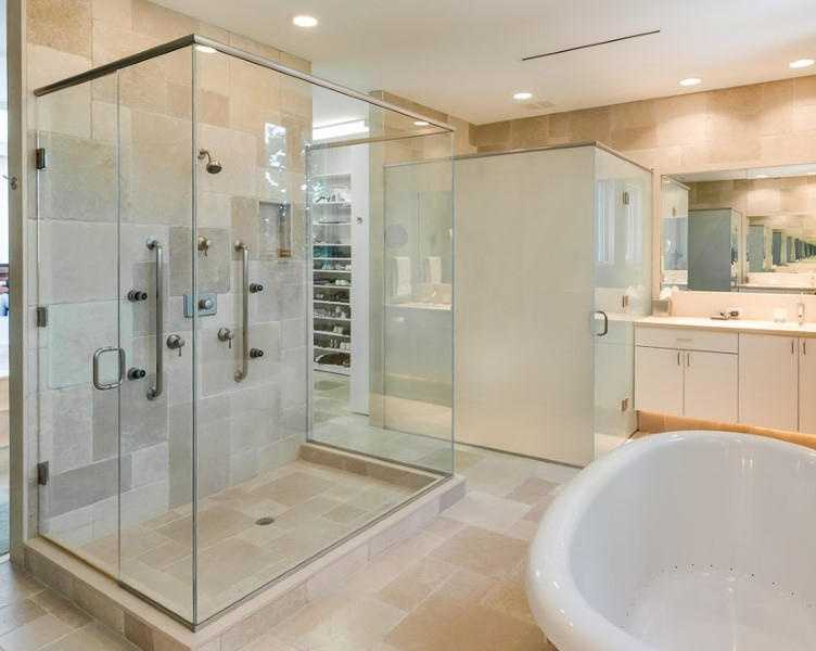 On the other side of the huge master closet, is the en suite bathroom. It features a large free-standing tub, and a equally large shower.