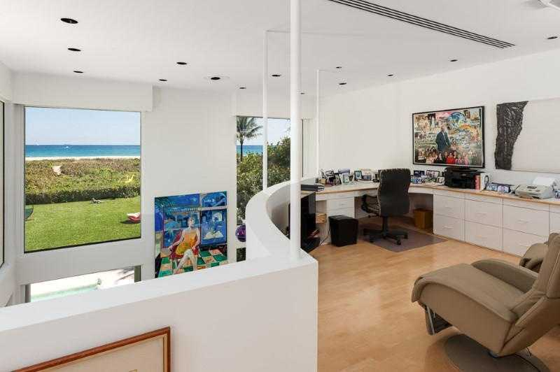 A top-floor, loft area has been converted into a beautiful office overlooking the ocean.