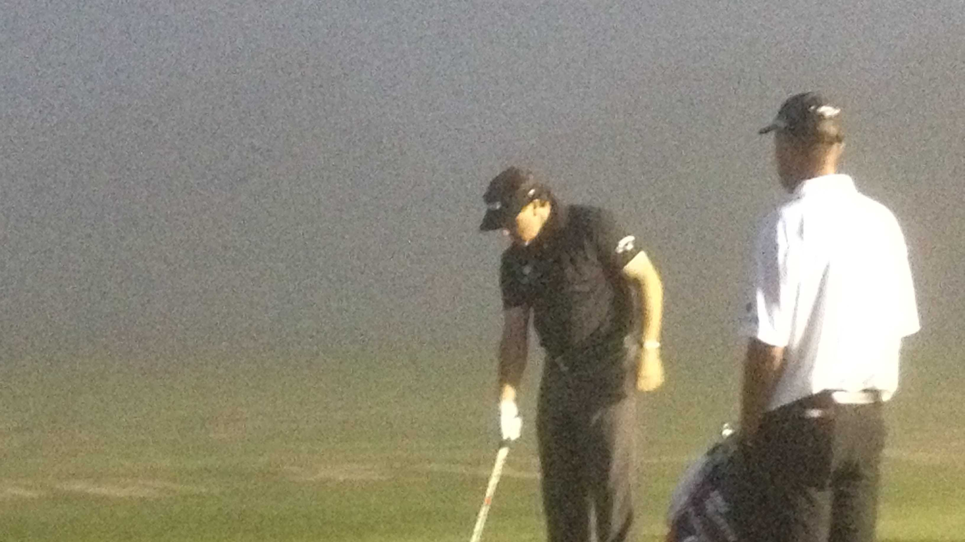 Phil Mickelson battles the fog at the practice range at PGA National early Wednesday morning.
