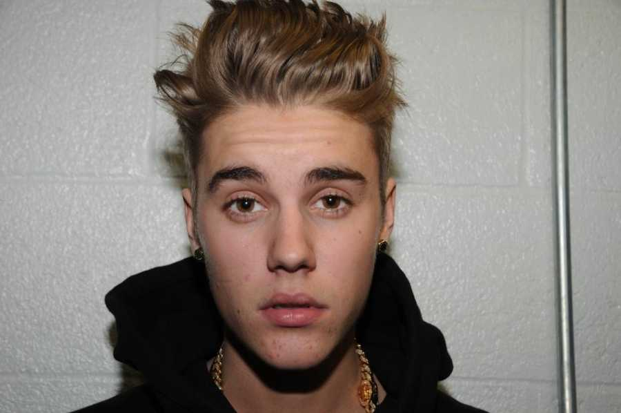 A judge in Miami Beach on Tuesday ordered the release of photos taken the night pop star Justin Bieber was arrested there in January. Take a look at the photos Bieber showing off many of his 22 tattoos.
