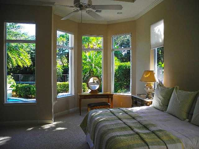 Beautiful bay windows offer views of the pool in the master suite.