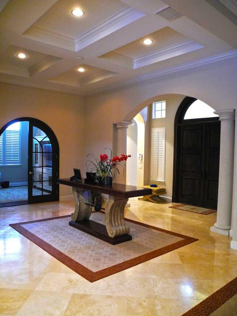 Beautiful marble floors and structured ceilings in the foyer.