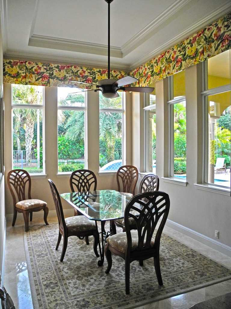 Cute kitchen nook also includes hurricane impact resistant windows.