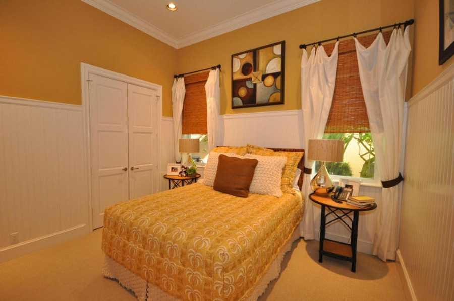 This bedroom features a walk-in closet.
