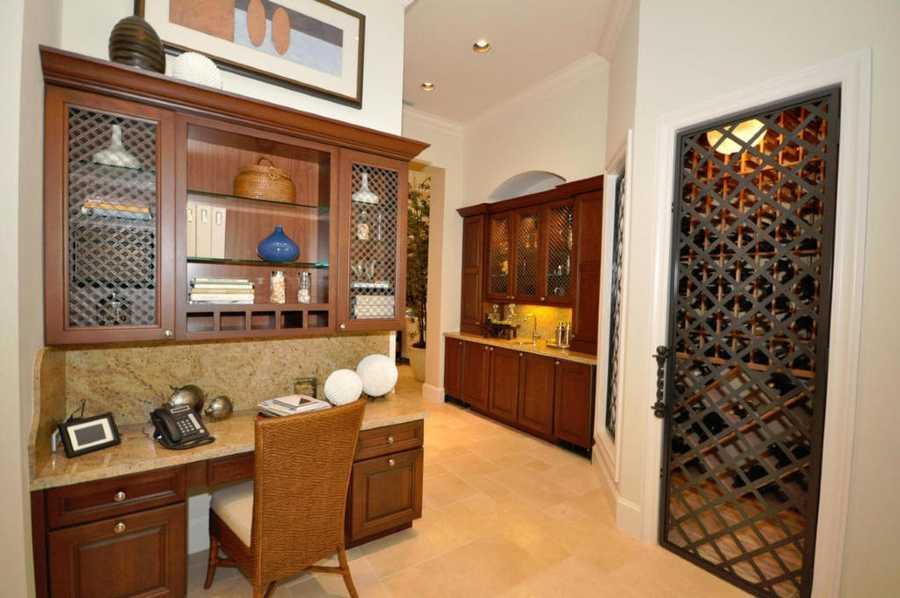 A kitchen also boasts a magnificent wine cellar.