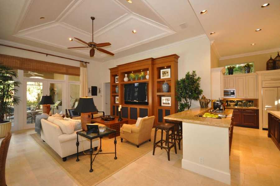 The kitchen flows to the family room.