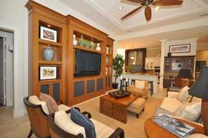Custom, wooden entertainment unit in the comfortable family room.