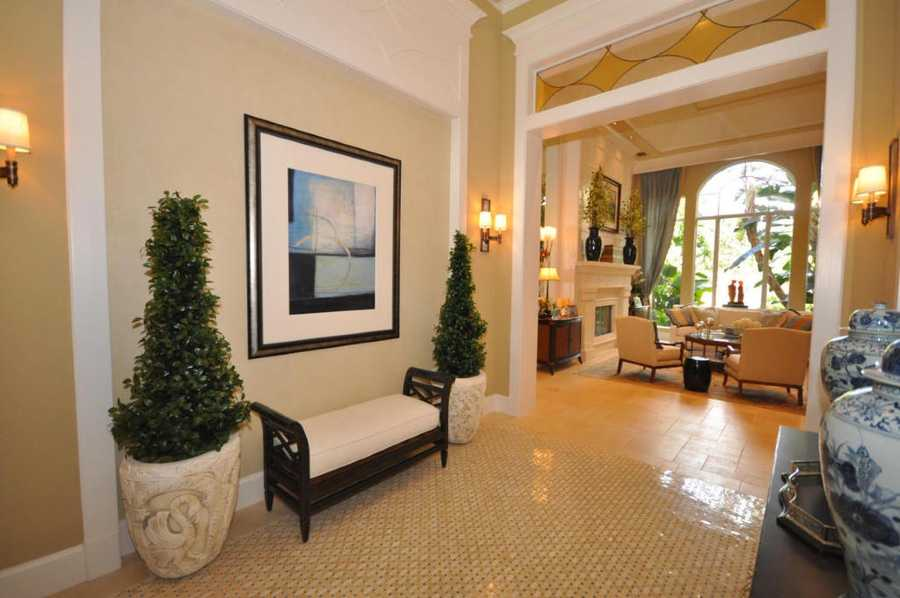 To the left of the foyer is an upscale living room.