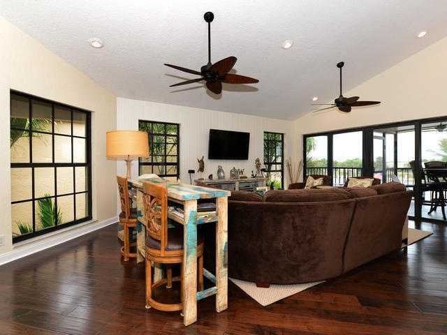 Family room offers perfect views of the waterway.