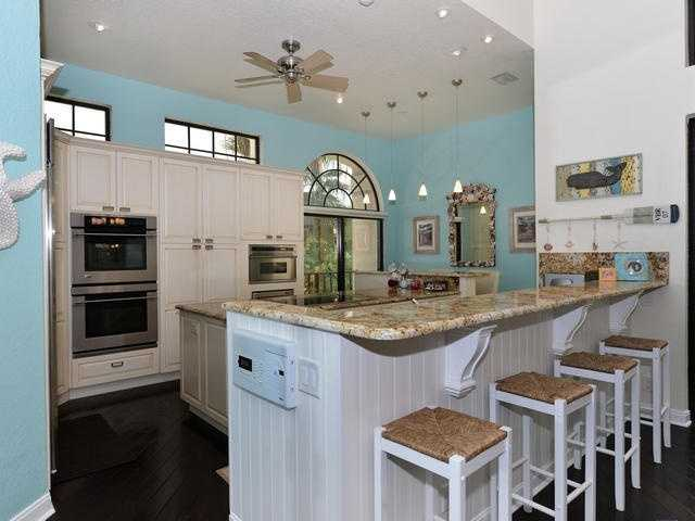 The kitchen was renovated in 2007 and features custom wood cabinets and granite tops.