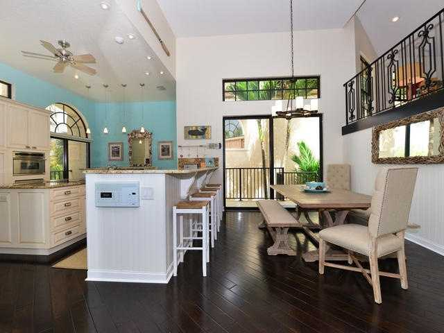 Below the kitchen's balcony is a charming dining area.