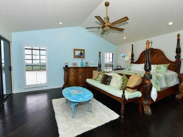 Beautiful master bedroom has plenty of windows for natural light.